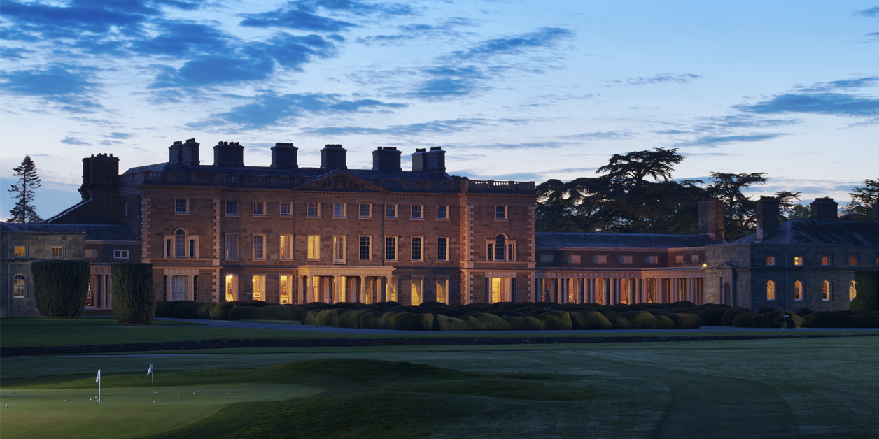 Night view of the exterior of Accor's Carton House