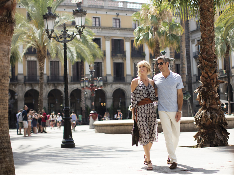 Man and woman couple walking the streets of Barcelona.