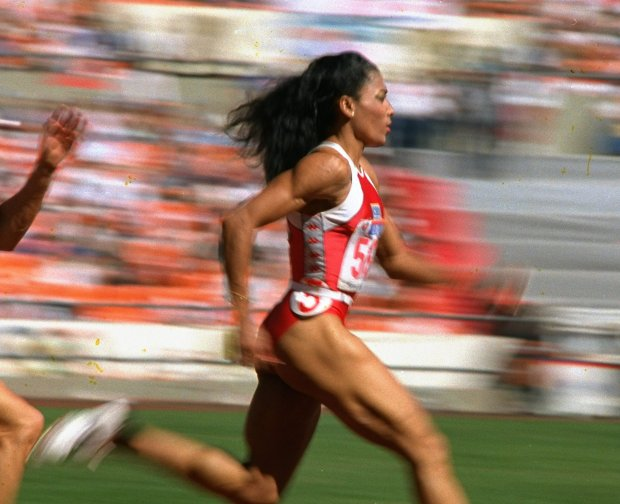 Image of woman racing to the finish line