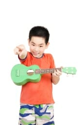 Little boy with ukulele