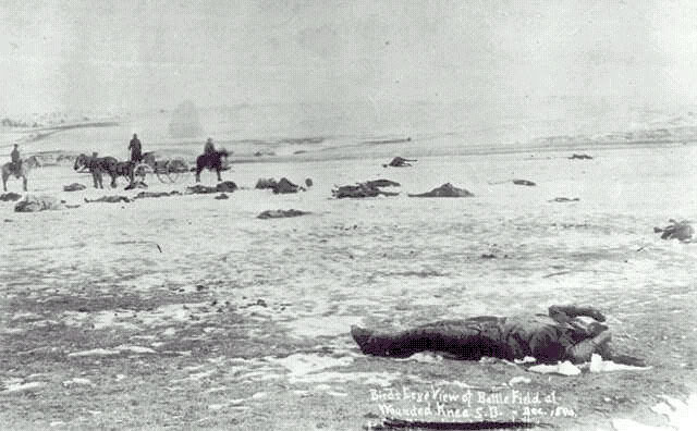 Victims of Wounded Knee Laying in The Snow (https://en.wikipedia.org/wiki/Wounded_Knee_Massacre)