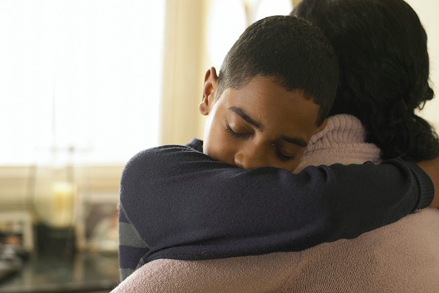 Boy hugging mom