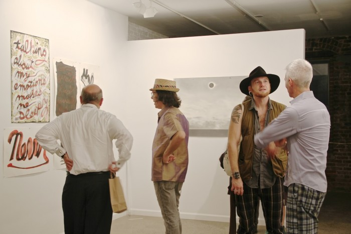 Artist Marshall Weber (2nd from left wearing straw hat) with guests during opening at Munch Gallery