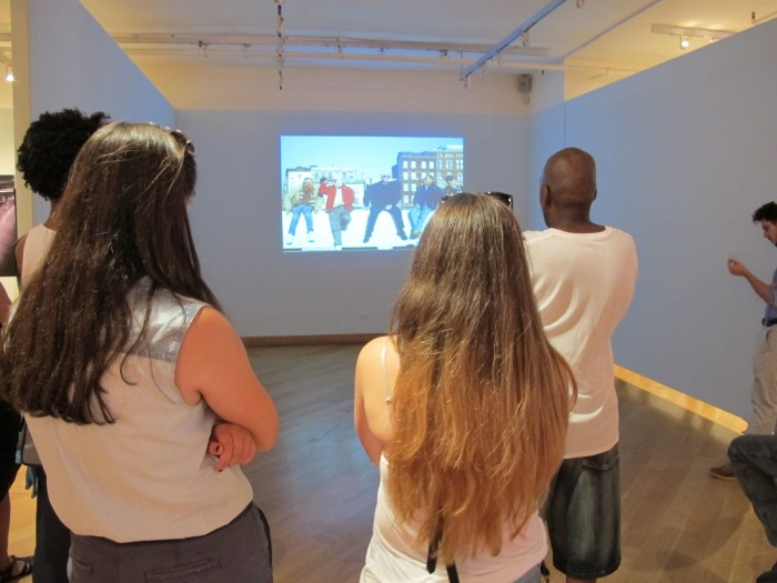 Visitors take in Richard Renaldi's multimedia piece, PIER 45.