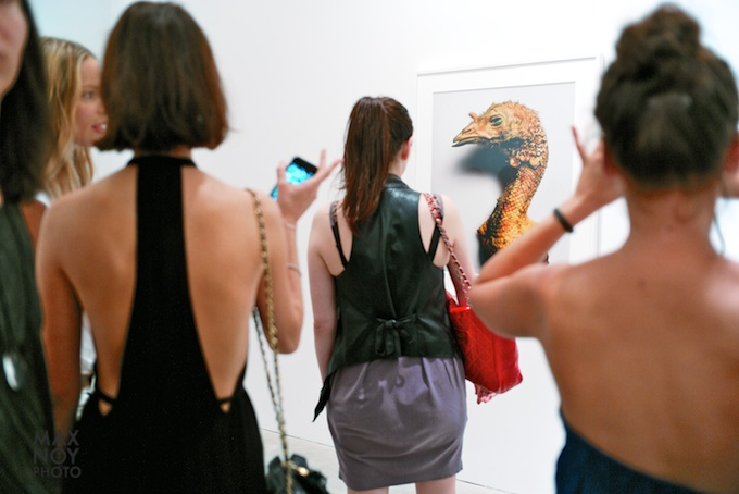 Graceful lines on the photo and on the backs of the fashionable art crowd at PACE