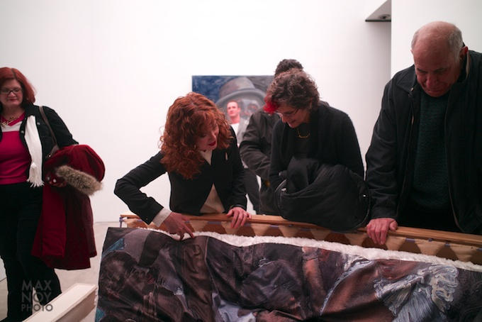 Ena Swansea (2nd from left) shows off her art to curious guests