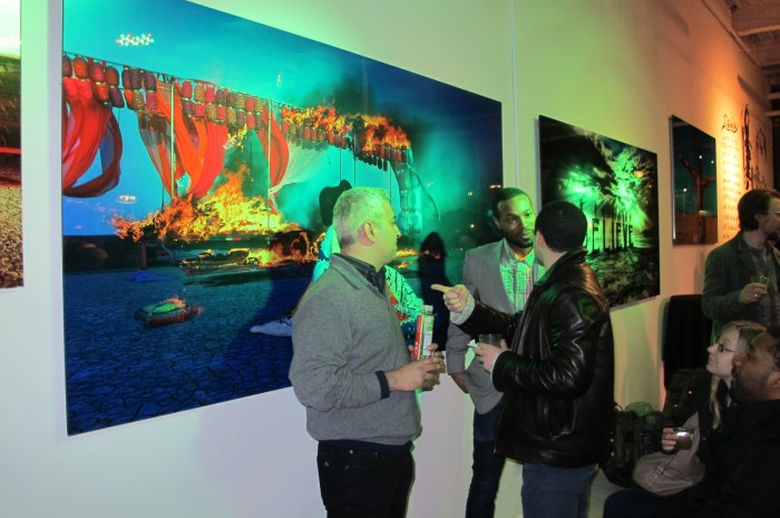Art lovers chatting at the opening of Imagine