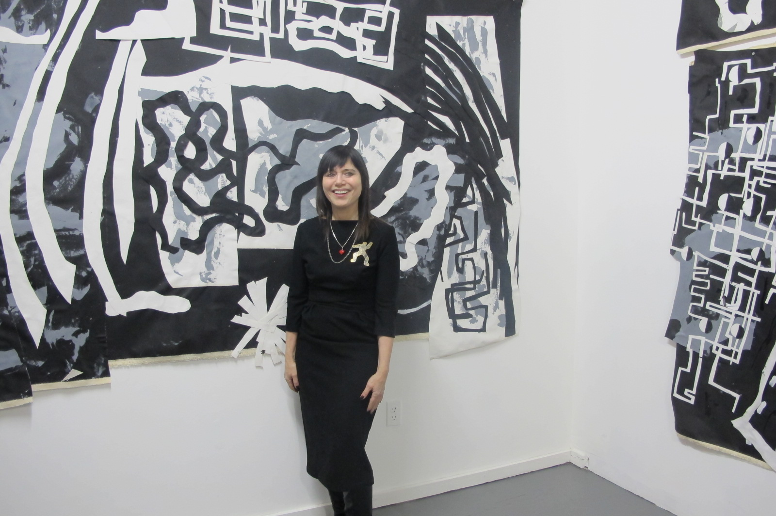 Judy Rifka with her work in the main Trestle Project space