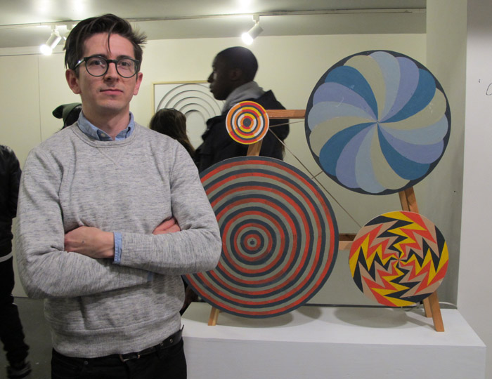 Aritst Nick Doyle next to his kinetic sculpture Hypno