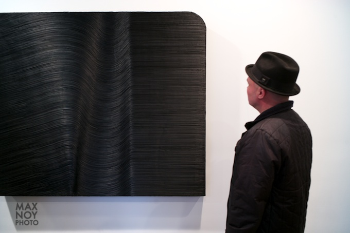Artist David Lyle admiring the work of James Austin Murray at LWG