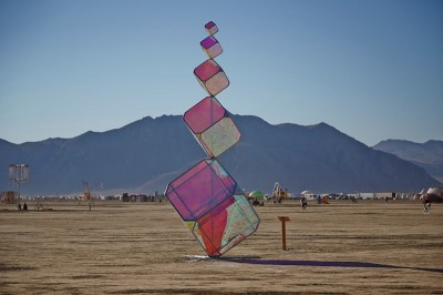 Invisible, Kirsten Berg (image by Evan Novis) (In)Visible is a juncture of forms and light. Its sleek, shimmering cuboid forms rise 21' high, creating a balanced pillar of prisms.