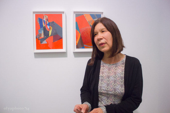 Artist Mary Lum with her works