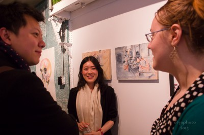 Amy Li (at center) with guests at the opening for Erin Smith