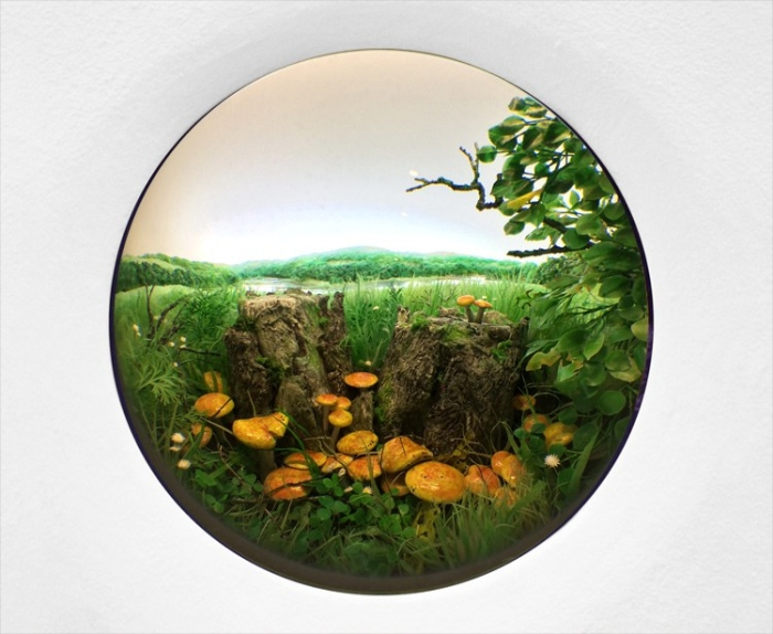 "Patrick Jacobs ""Double Stump with Rustgill Mushrooms,"" 2015 Diorama viewed through 2.75 in. (7cm) window. 18.5 (W) x 12.75 (H) x 11.5 (D) in. (47 x 32 x 29 cm). Styrene, acrylic, cast neoprene, paper, polyurethane foam, ash, talc, starch, acrylite, vinyl film, copper, wood, steel, lighting, BK7 glass"