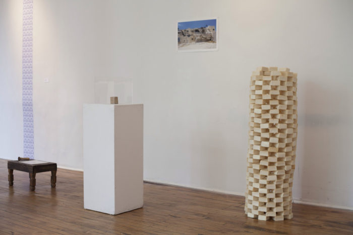 LANA ABU-SHAMAT Masbanet Abu Shamat 1500-2002 (Abu Shamat Soap Factory), 2014 Handmade olive oil soap, original Abu Shamat soap bar (1990), digital image (2010), wooden stool, customized copper stamp, soap wrapping paper, acrylic display cube