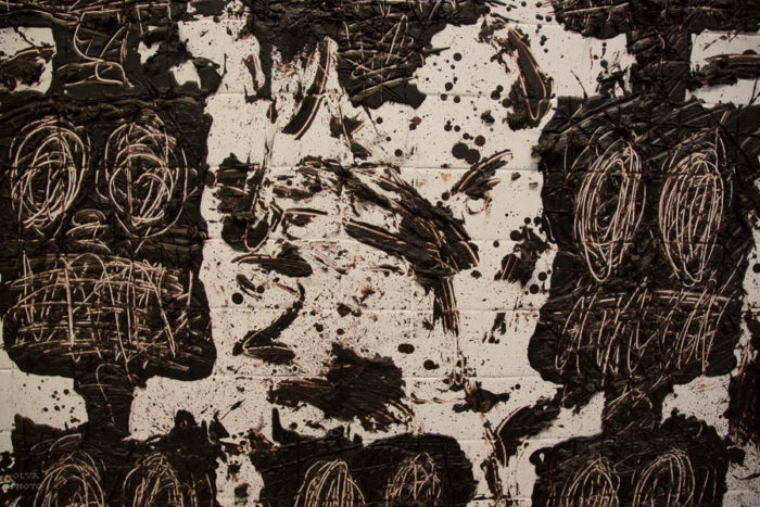 Detail of anxious audience by Rashid Johnson