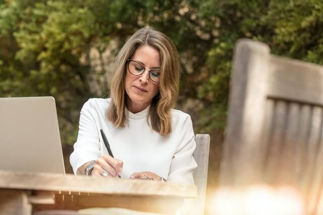 woman writing classic cell therapy
