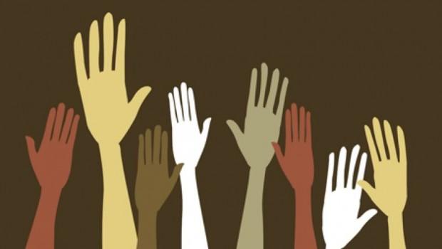 Voters' hands raised