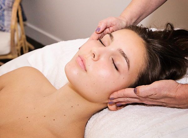 woman receiving facial at body essentials of ojai