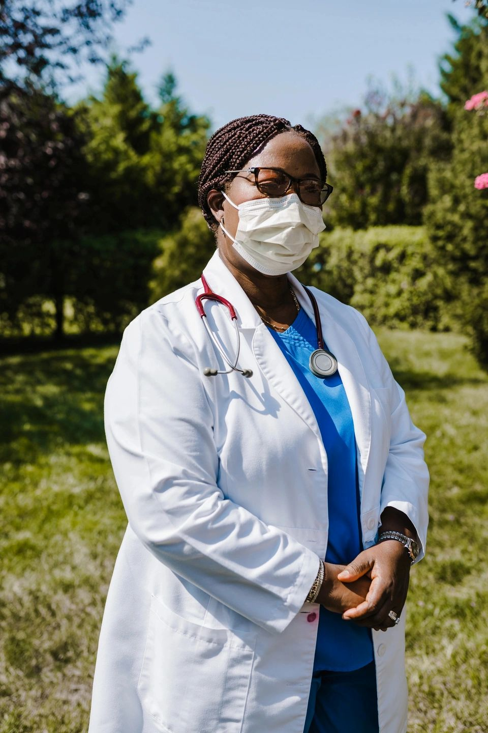 female doctor with white coat and mask