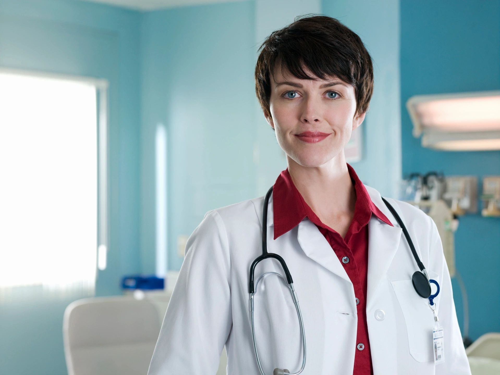 Female doctor with white coat and stethoscope