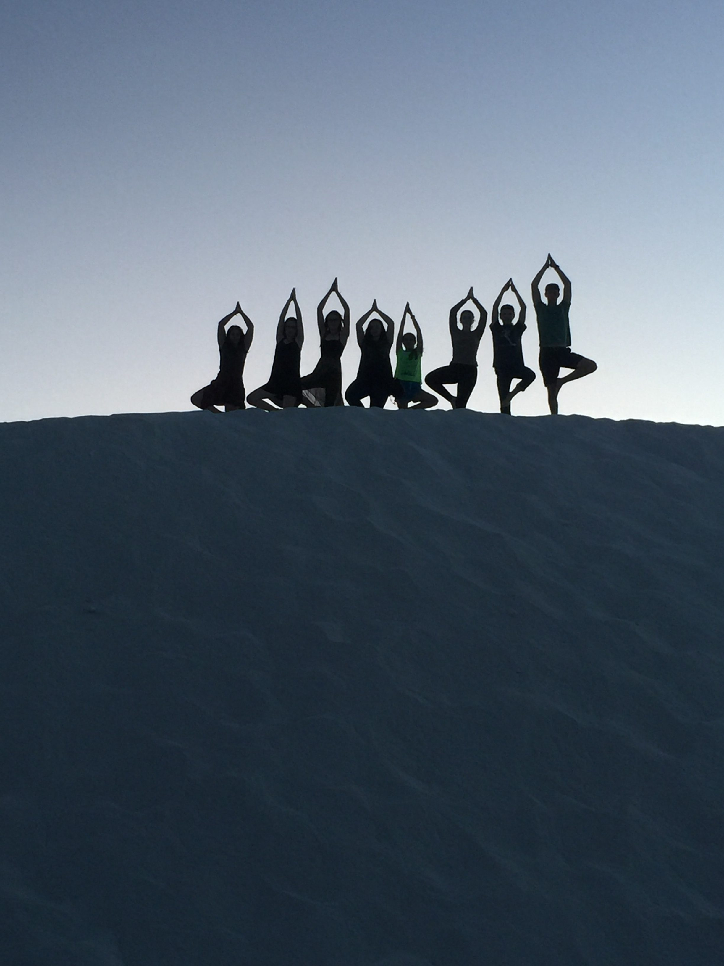 Students on Dune In Tree Pose Vrikshasana