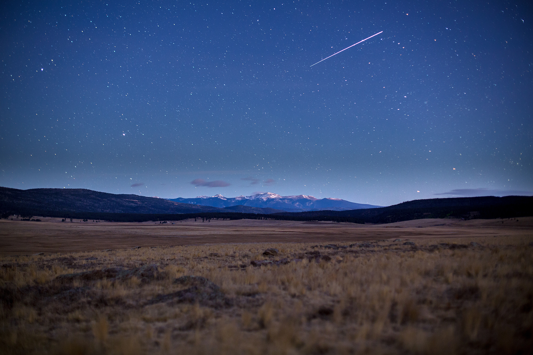 Shooting star over the Moreno Valley in New Mexico under moon light