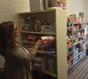 Our Parish Administrator stocking the Food Pantry