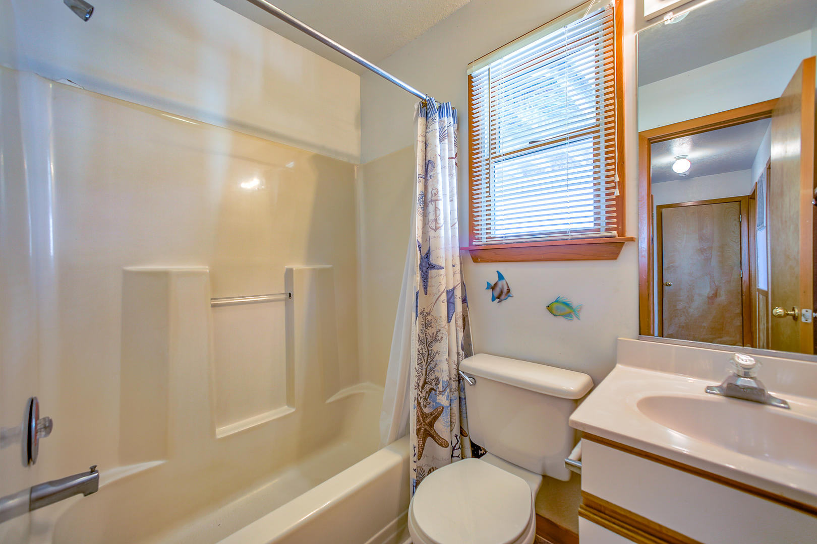 Middle level shared bathroom near laundry room