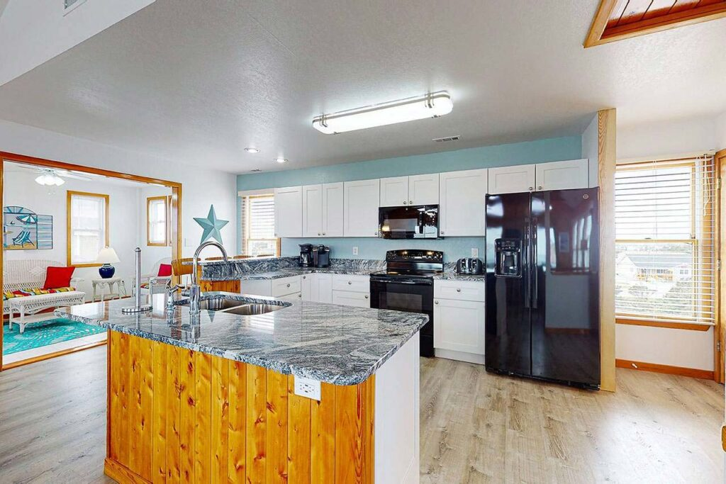 Fully equipped kitchen with granite countertops on main level