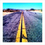 A dry and cracked road into the desert ahead if we refue to deal with climate change. www.lynncrounse.com