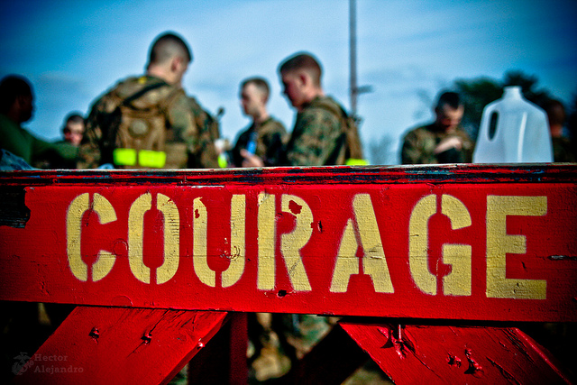 soldiers with courage sign