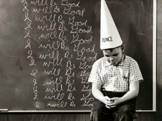 boy with dunce cap