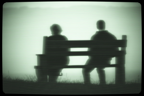 photo of couple on bench TV screen style