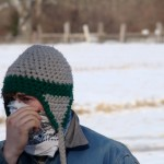 person covering face in cold