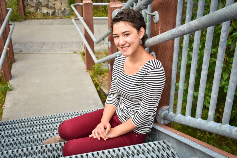 Asian senior girl portrait on metal stairs in Alaska.