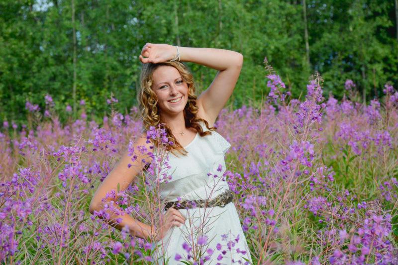 Senior girl portrait in a field of fireweed in Palmer, Alaska.