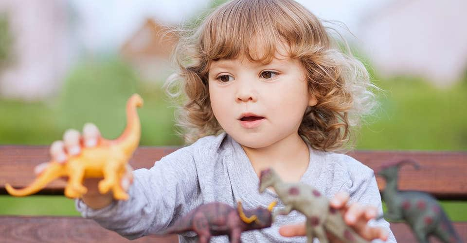 Toddler Playing with Dinosaurs