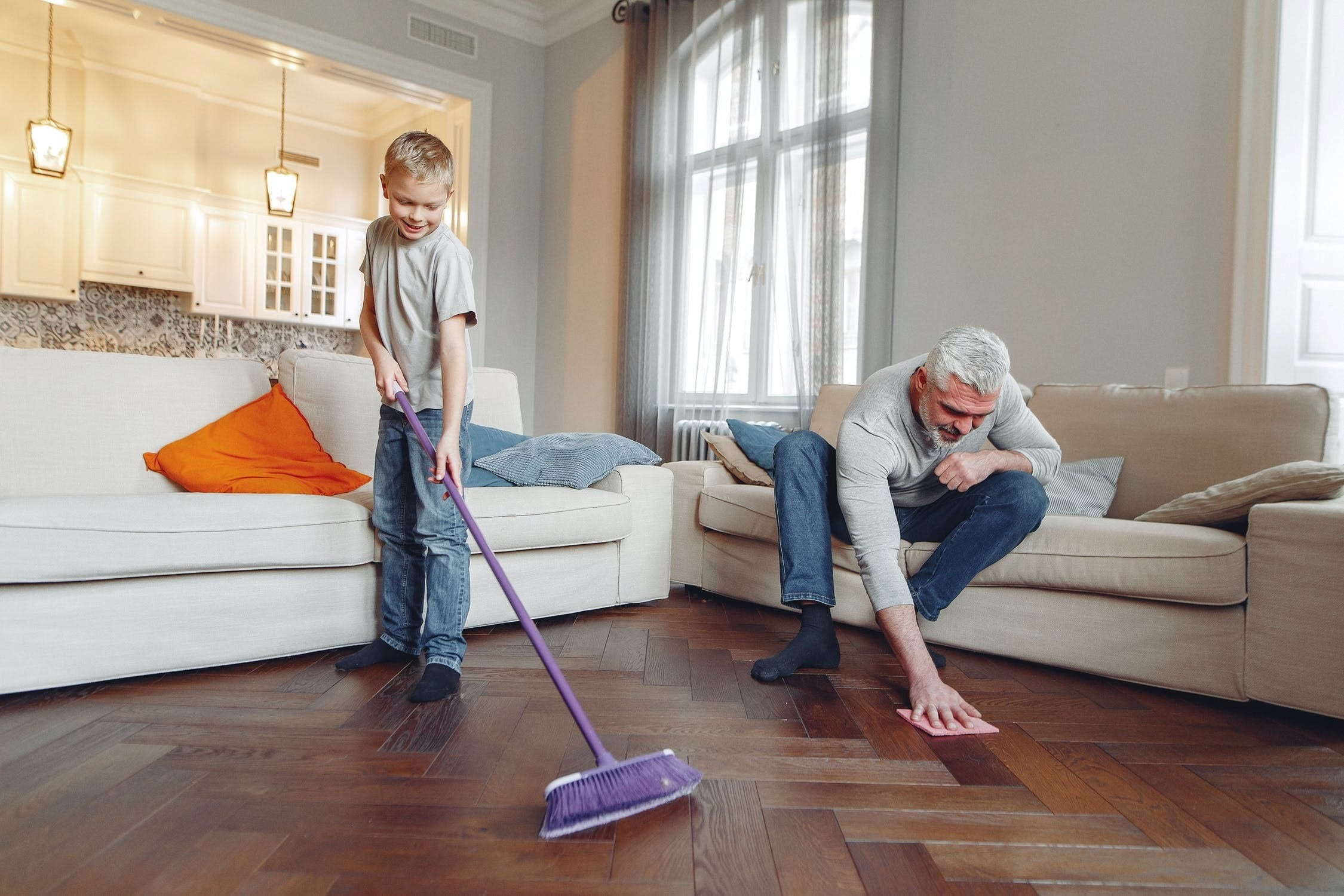 Father and son cleaning home daycare