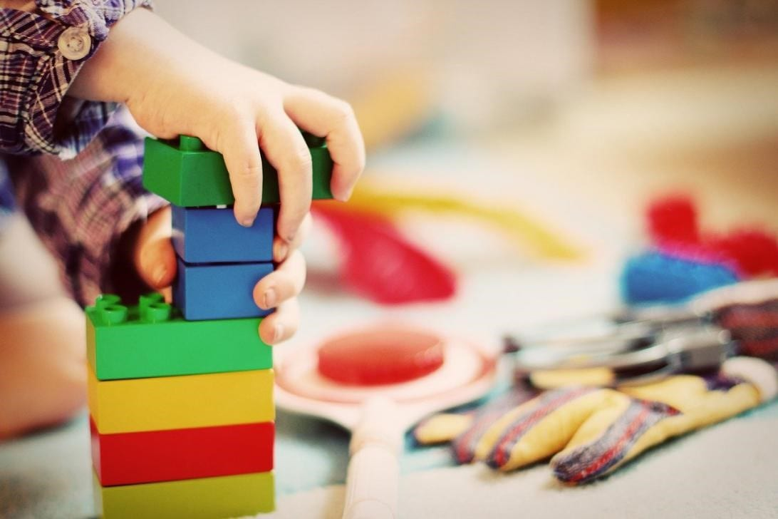 a child playing with building blocks