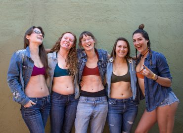 Arêt Basewear founders and employees smiling and laughing in their basewear top sports bras