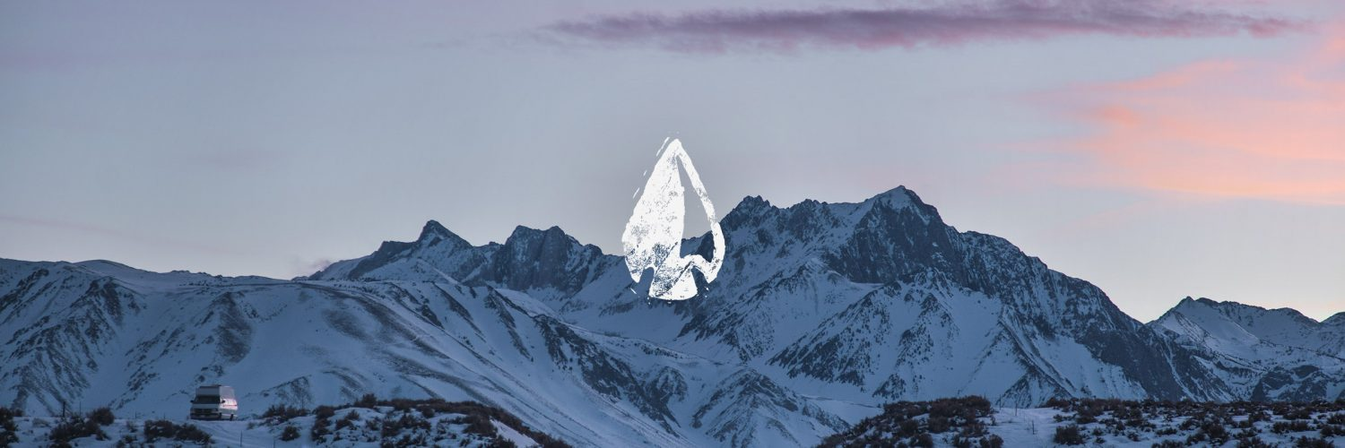Têra Kaia Basewear logo over a snowy mountain with purple sunset. Kicking off 2020 with our time capsule article.