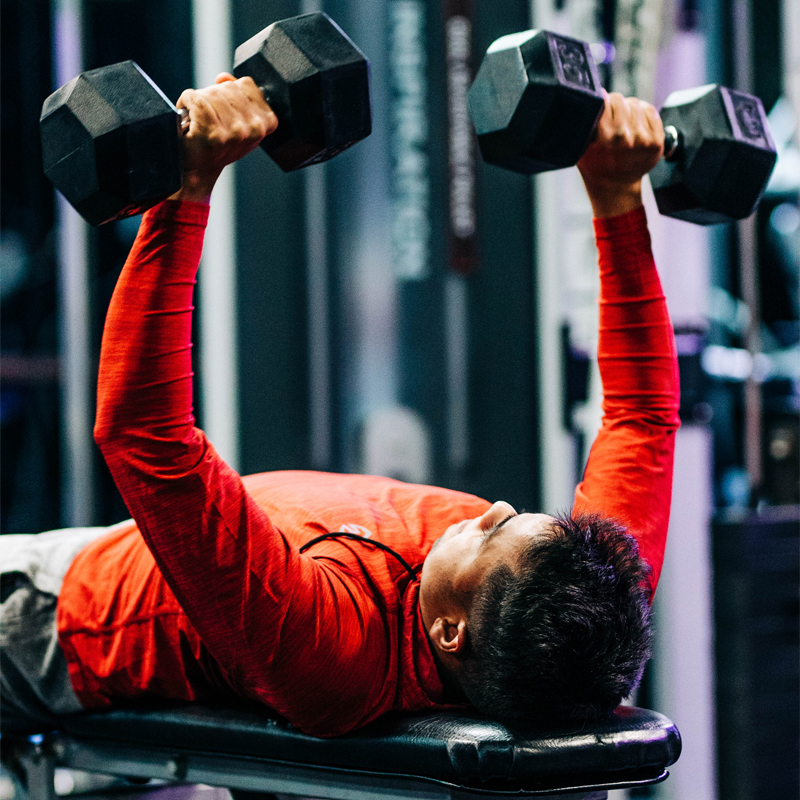 Working chest muscless with a personal trainer