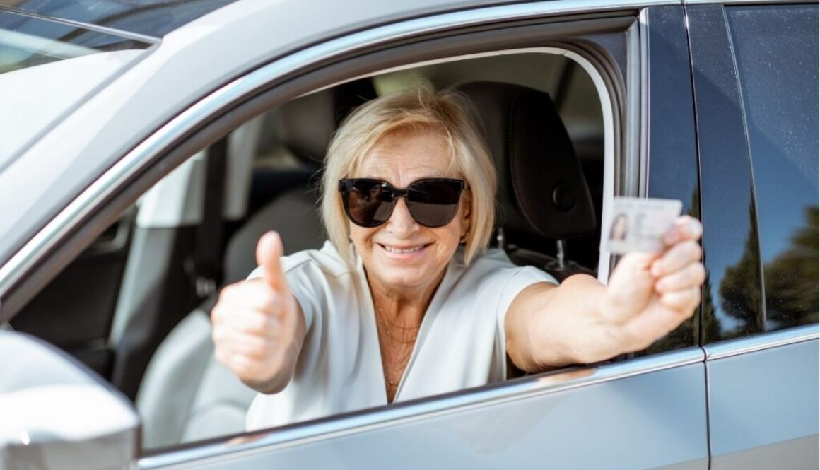 A woman who is giving the thumbs up sign after renewing her drivers license.
