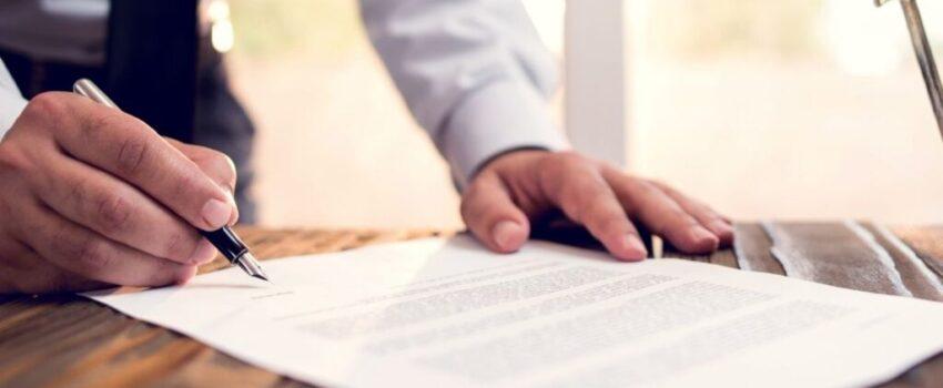 Middle aged man filling up the legal estate documentation