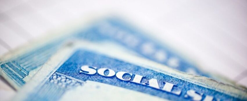 Social security cards with a blurry background.