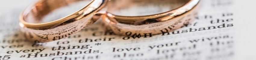 2 marriage rings placed in a legal documents after changing the spouse name
