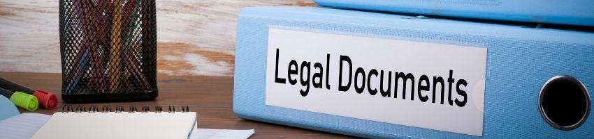 Legal Documents Labeled in blue documents organizer under the wooden table