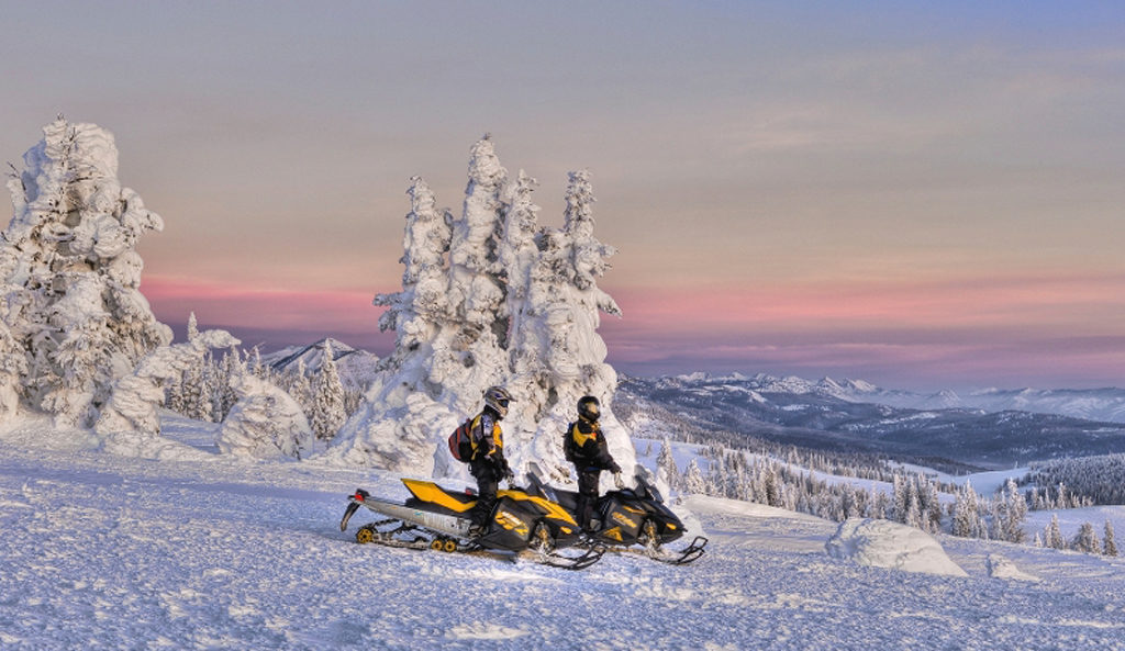 snowmobiling in yellowstone in the winter
