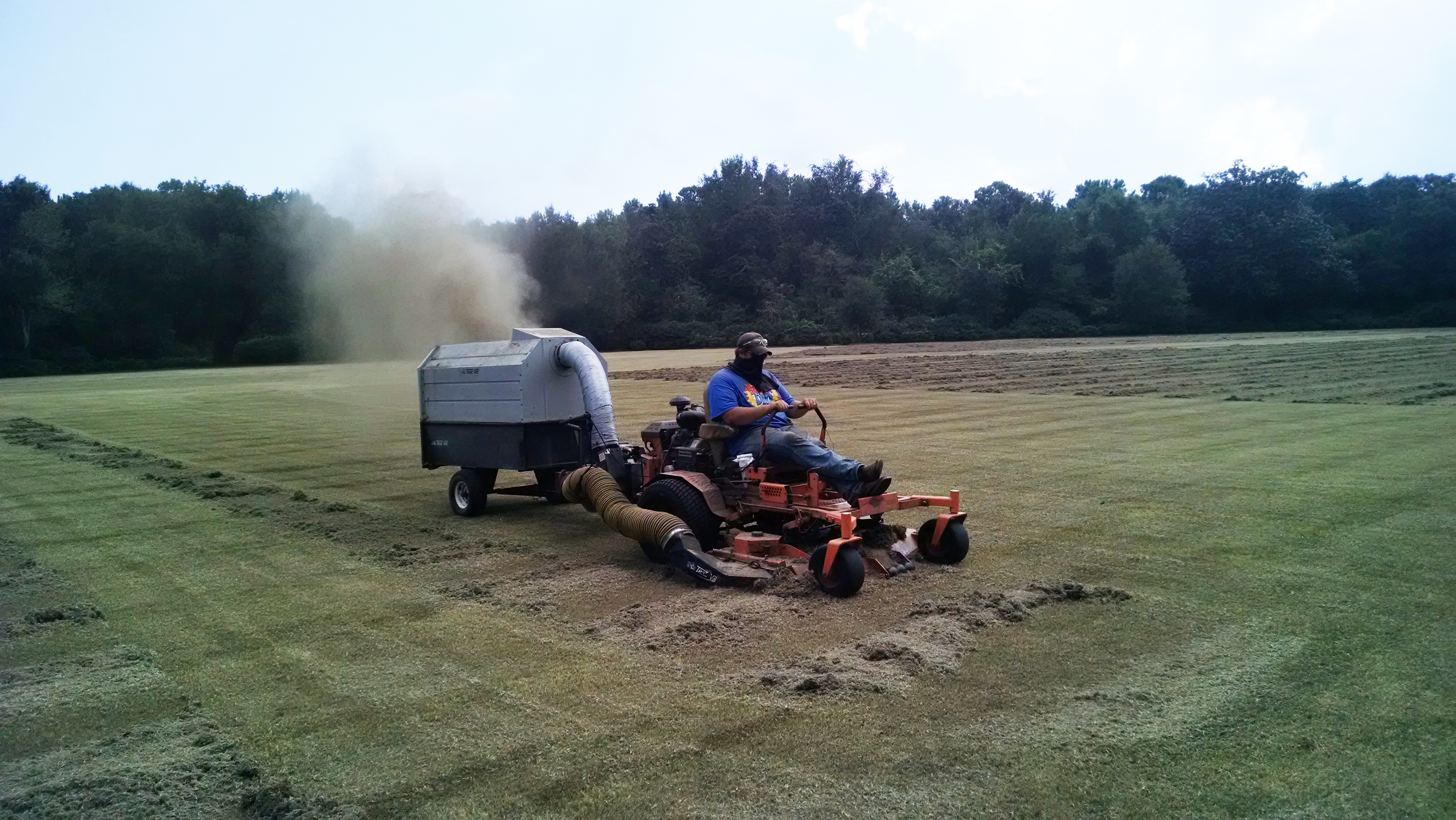 After giving the Great Lawn a close shave, gardeners vacuum the clippings.